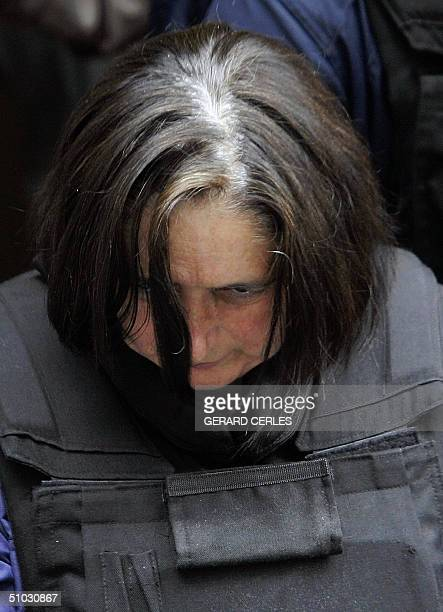 Wife of French serial killer Michel Fourniret, Monique Olivier, arrives 07 July 2004, for a hearing at Dinant police headquarters. Fourniret...