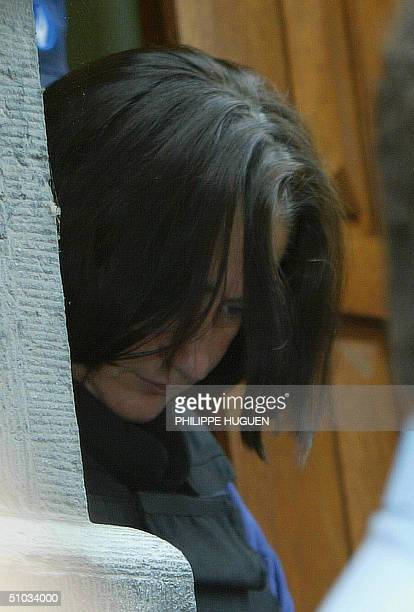 Wife of French serial killer Michel Fourniret, Monique Olivier arrives 07 July 2004, for a hearing at Dinant police headquarters. Fourniret confessed...