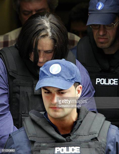 Wife of French serial killer Michel Fourniret, Monique Olivier is escorted by police as she arrives 07 July 2004, for a hearing at Dinant police...