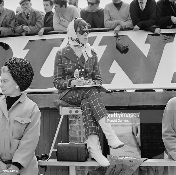 Wife of Jackie Stewart Helen Stewart watching the action at the Silverstone Circuit 28th April 1967