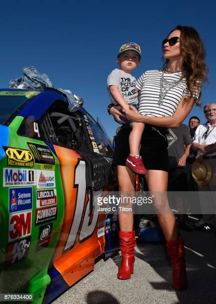 Wife of Kyle Busch driver of the MM's Caramel Toyota Samantha Busch and their son Brexton take part in prerace ceremonies for the Monster Energy...