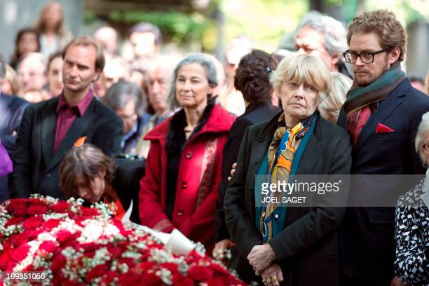 Wife of late Guy Carcassonne Claire Bretecher stands on June 3 2013 at the Montmartre cemetery in Paris during the funeral of the French University...