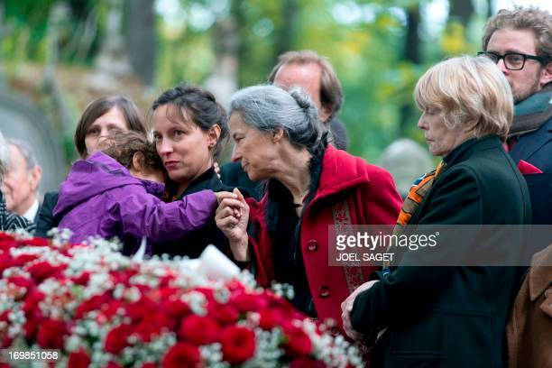 Wife of late Guy Carcassonne Claire Bretecher stands on June 3 2013 at the Montmartrecemetery in Paris during the funeral of the French University...