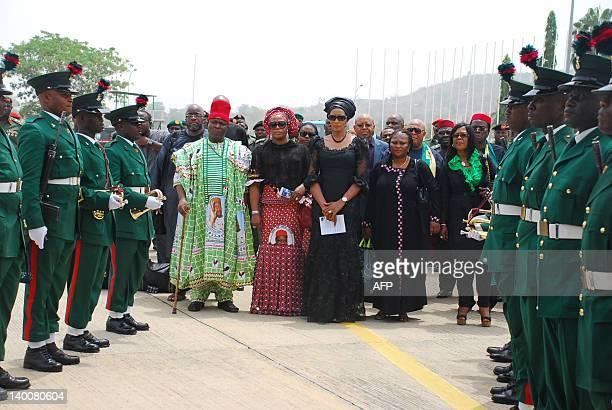 Wife of late Nigeria's secessionist leader Odumegwu Ojukwu Bianca Ojukwu Ikemba mourns upon arrival of her husband remains in Abuja on February 27...
