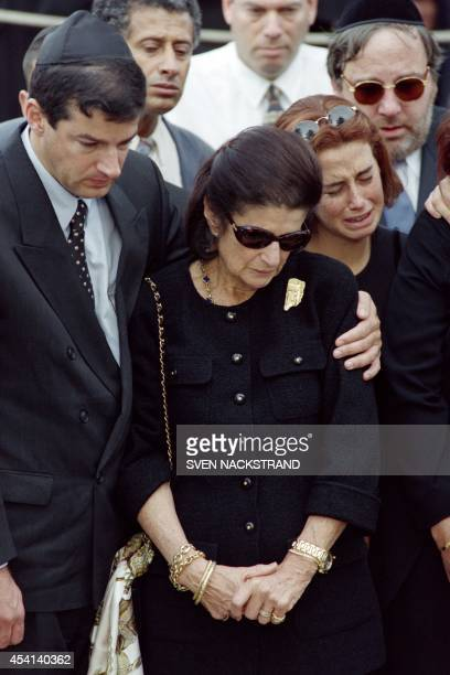 Wife of late Prime Minister Yitzhak Rabin Lea Rabin her son Yuval and her granddaughter Noah Ben Artzi grieve over the tomb of the Israeli leader...