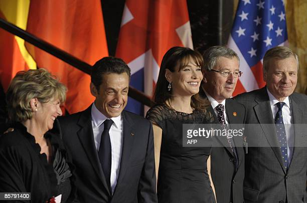 Wife of Luxembourg Premier Christiane Frising French President Nicolas Sarkozy his wife Carla BruniSarkozy Luxembourg Premier JeanClaude Juncker and...
