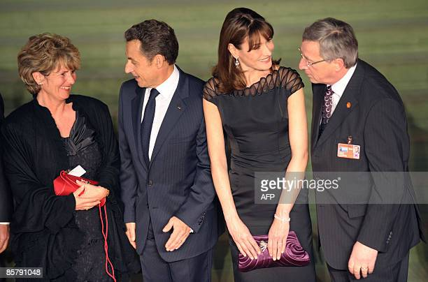 Wife of Luxembourg Premier JeanClaude Juncker Christiane Frising speaks with French President Nicolas Sarkozy while Sarkozy's wife Carla BruniSarkozy...