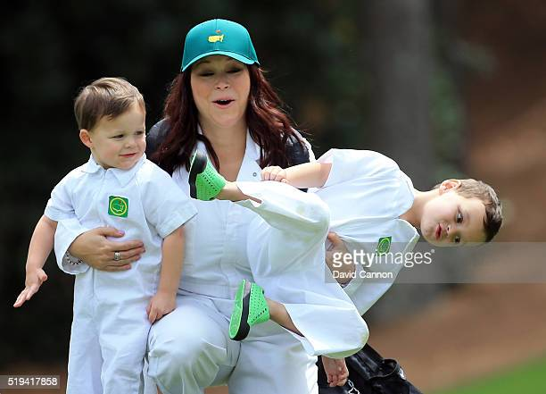 Wife of Marc Leishman of Australia, Audrey Hills and their sons Oliver and Harvey attend the Par 3 Contest prior to the start of the 2016 Masters...