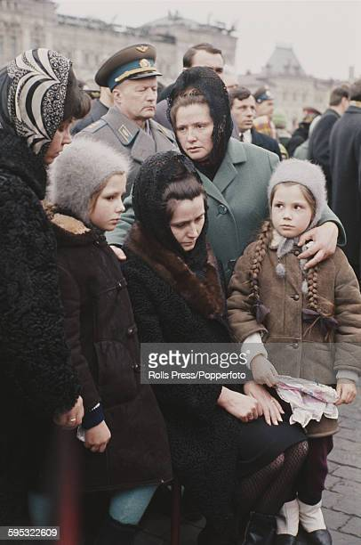 Wife of Russian cosmonaut Yuri Gagarin Valentina Gagarin sits with her two daughters Yelena and Galina in Red Square Moscow during the funeral...
