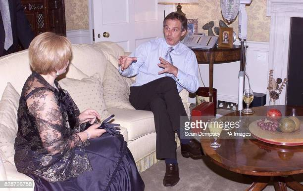 Wife of Russian President Vladimir Putin Lyudila sits with Prime Minister Tony Blair in Downing Street London during their official state visit to...