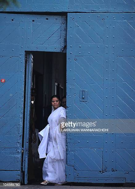 Wife of Sri Lanka's jailed exarmy chief Sarath Fonseka Anoma Fonseka emerges from the main prison in Colombo on October 1 2010 Fonseka who fell out...