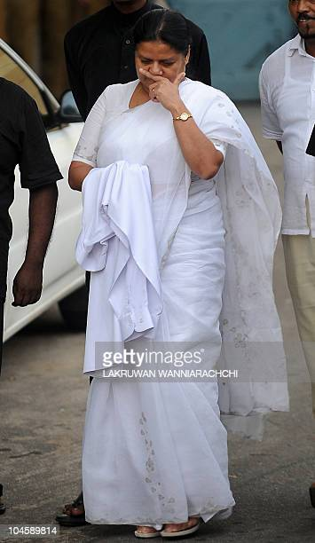 Wife of Sri Lanka's jailed exarmy chief Sarath Fonseka Anoma Fonseka weeps as she carries her husband's clothes as she leaves the main prison in...