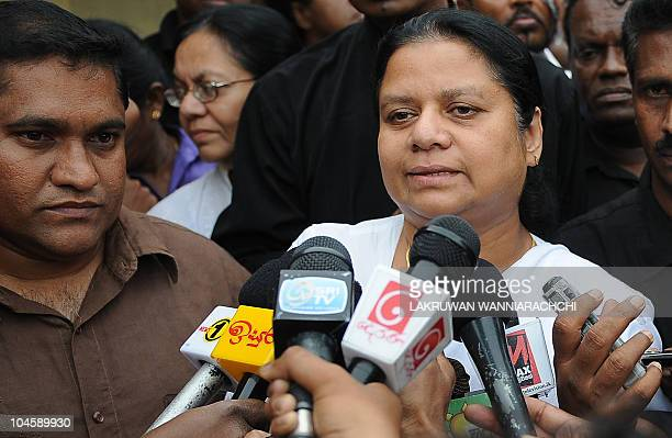 Wife of Sri Lanka's jailed exarmy chief Sarath Fonseka Anoma Fonseka speaks to reporters after visiting her husband at the main prison in Colombo on...