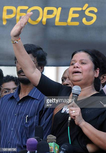 Wife of Sri Lanka's jailed exmilitary chief Sarath Fonseka Anoma Fonseka addresses supporters attending a rally in Colombo on October 11 2010...