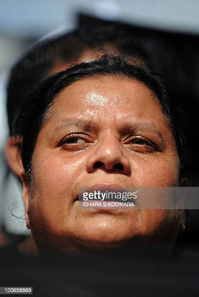 Wife of Sri Lanka's jailed exmilitary chief Sarath Fonseka Anoma Fonseka attends a demonstration outside the main prison in Colombo on August 8 2011...