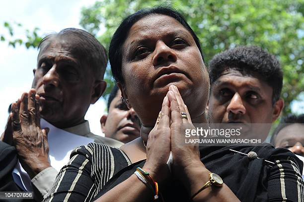 Wife of Sri Lanka's jailed exmilitary chief Sarath Fonseka Anoma Fonseka joins opposition lawyers in protest calling for her husband's release...