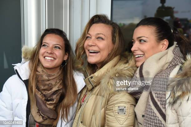 Wife of the folk musician Hansi Hinterseer Romana and their daughters Laura and Jessica visit the Hahnenkamm Race in Kitzbuehl, Austria, 24 January...