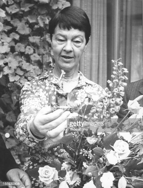 Wife of the German Federal Chancellor Helmut Schmidt Hannelore Loki Schmidt holding flowers October 11 Bonn Germany
