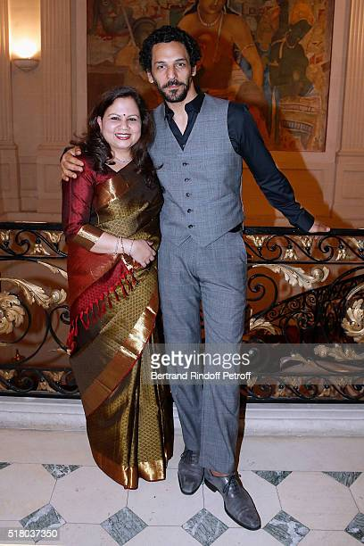 Wife of the Indian Ambassador to Paris Mala Kumar and actor Tomer Sisley attend the Tribute to Indian actor and director Kamal Haasan during the...
