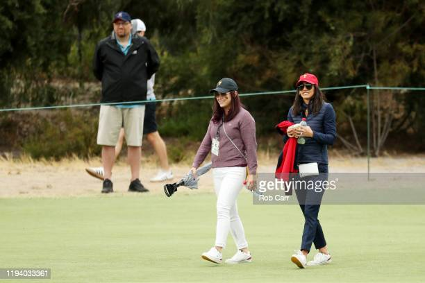 Wife pf Marc Leishman of Australia and the International team Audrey Leishman and wife of Rickie Fowler of the United States team Allison Stokke walk...