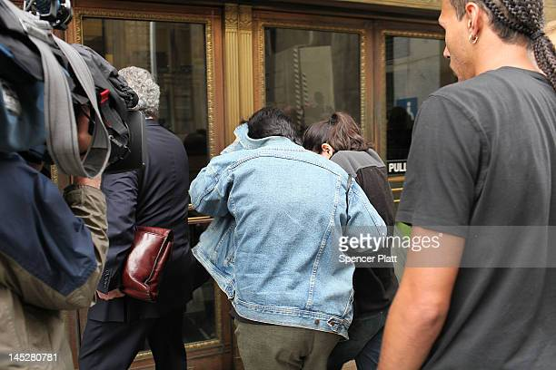 Wife Rosemary Hernandez and daughter Becky Hernandez of alleged Etan Patz murderer suspect Pedro Hernandez walk away from a courthouse with a lawyer...