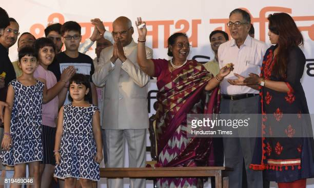 Wife Savita Kovind family members and grand children offering sweets to Ram Nath Kovind after his win in Presidential election at 10 Akbar Road on...