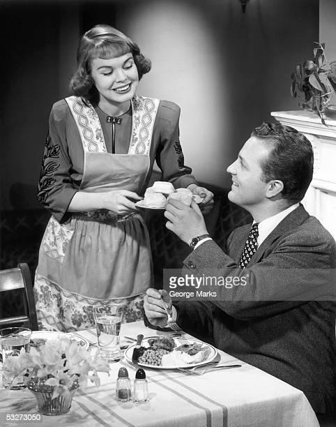 Wife serving husband dinner