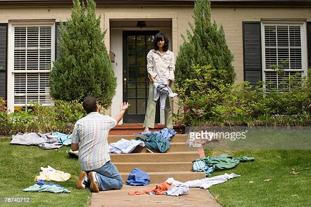 Wife Throwing Her Husband Out of the House