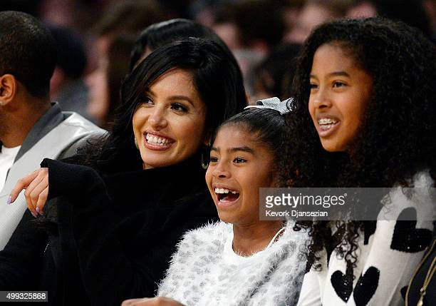Wife Vanessa Laine Bryant and daughters Gianna Bryant and Natalia Bryant watch Kobe Bryant of the Los Angeles Lakers during the basketball game...