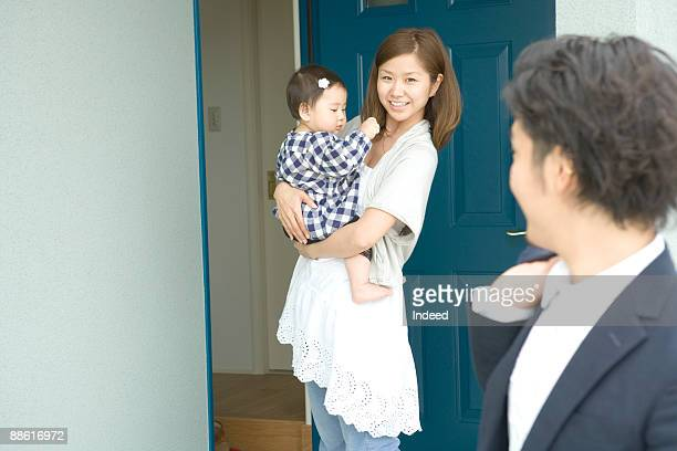 Wife with daughter smiling to leaving husband