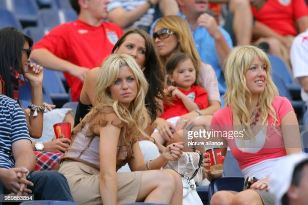 Wifes and girlfriends of English players smile prior to the group B match of 2006 FIFA World Cup between England and Paraguay in Frankfurt on...