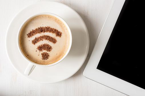 WiFi symbol made of cinnamon as coffee decoration 514554738