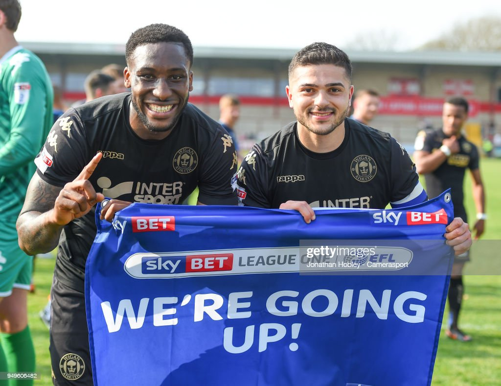 Wigam players celebrate after securing promotion to the Championship during the Sky Bet League One match between Fleetwood Town and Wigan Athletic at Highbury Stadium on April 21, 2018 in Fleetwood, England.