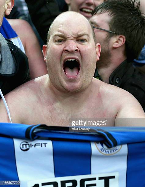 Wigan Athletic fan celebrates victory in the FA Cup with Budweiser Semi Final match between Millwall and Wigan Athletic at Wembley Stadium on April...