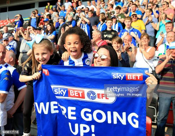 Wigan Athletic fans celebrate their sides promotion to the EFL Championship during the Sky Bet League One match at Highbury Stadium Fleetwood