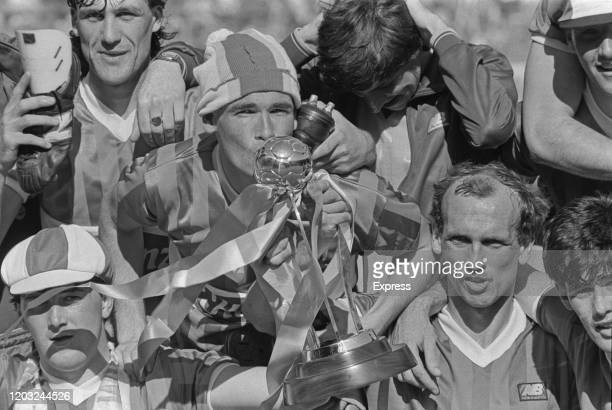 Wigan Athletic FC players celebrate after winning the EFL Trophy Final at Wembley Stadium London UK 1st June 1985