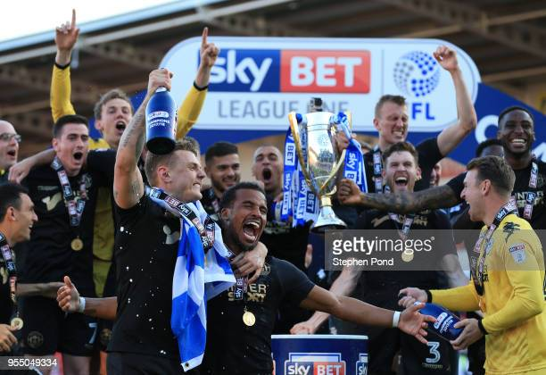 Wigan Athletic lift the trophy as they celebrate becoming League 1 Champions during the Sky Bet League One match between Doncaster Rovers and Wigan...