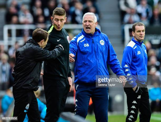 Wigan Athletic Manager Graham Barrow shouts at Fourth Official Robert Jones and Newcastle Unitedâs Assistant Manager Francisco De Miguel Moreno...
