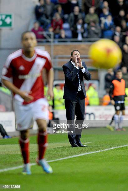 Wigan Athletic manager Malky Mackay shouts instructions during the Sky Bet Championship match between Wigan Athletic and Middlesbrough at DW Stadium...