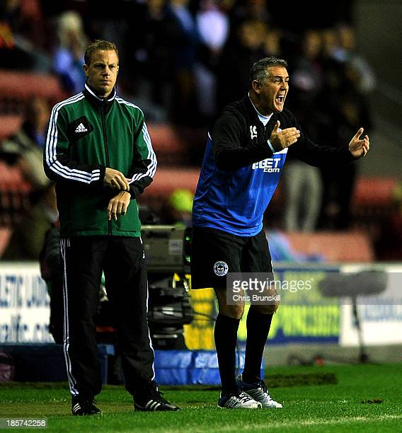 Wigan Athletic manager Owen Coyle shouts instructions from the touchline during the UEFA Europa League Group D match between Wigan Athletic and Rubin...
