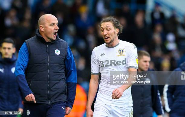 Wigan Athletic manager Paul Cook has words with Leeds United's Luke Ayling during the Sky Bet Championship match between Leeds United and Wigan...
