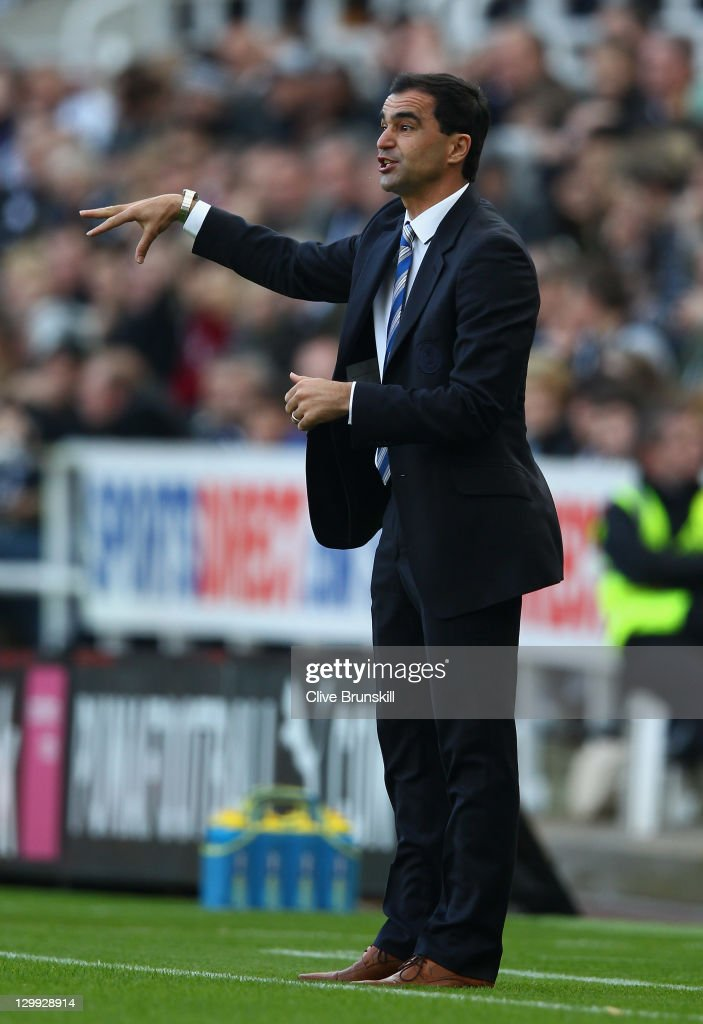 TYNE, ENGLAND - OCTOBER Wigan Athletic manager Roberto Martinez gives instructions to his team during the Barclays Premier League match between Newcastle United and Wigan Athletic at St James' Park on October 22, 2011 in Newcastle upon Tyne, England.