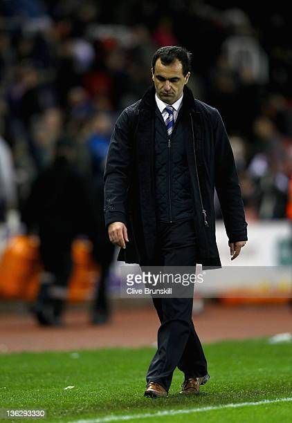 Wigan Athletic manager Roberto Martínez shows his dejection at the final whistle during the Barclays Premier League match between Stoke City and...