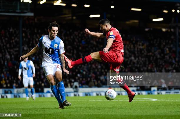 Wigan Athletic midfielder Sam Morsy and Blackburn Rovers defender Lewis Travis during the Sky Bet Championship match between Blackburn Rovers and...