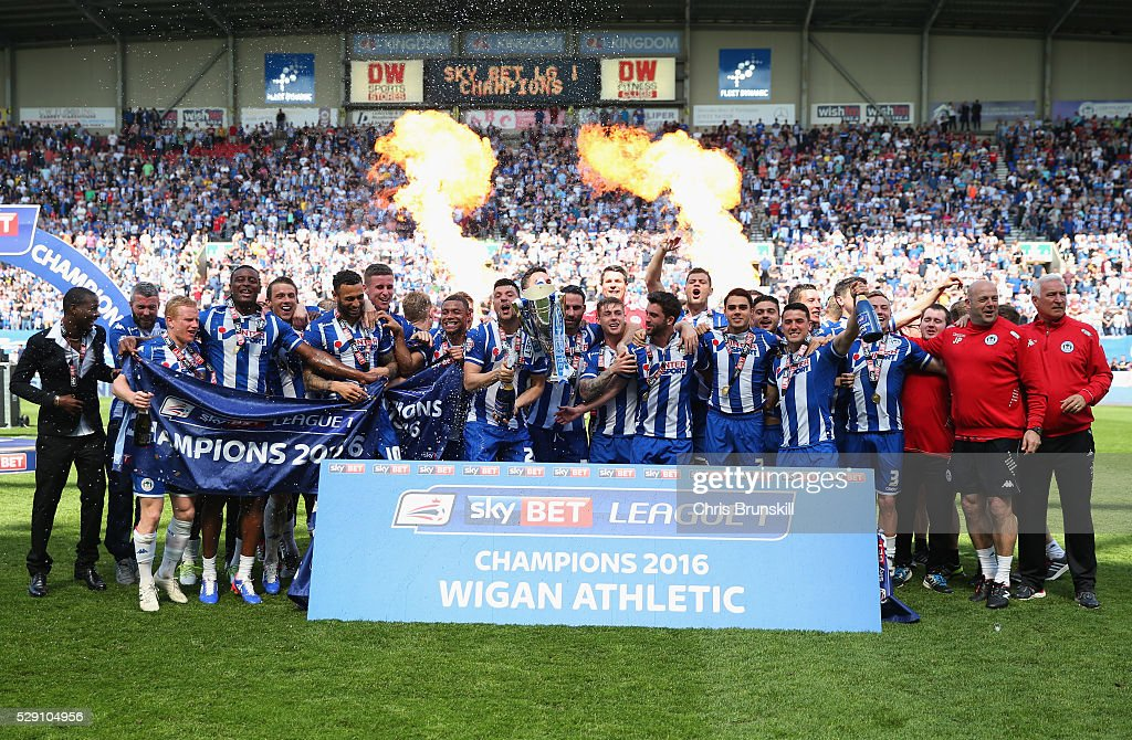 Wigan Athletic palyers celebrate with the trophy as they are crowned champions after the Sky Bet League One match between Wigan Athletic and Barnsley at DW Stadium on May 8, 2016 in Wigan, England.