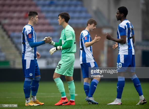 Wigan Athletic players Adam Long, Owen Evans, Chris Merrie and Emeke Obi motivate each other before the FA Cup 1st round match between Wigan Athletic...