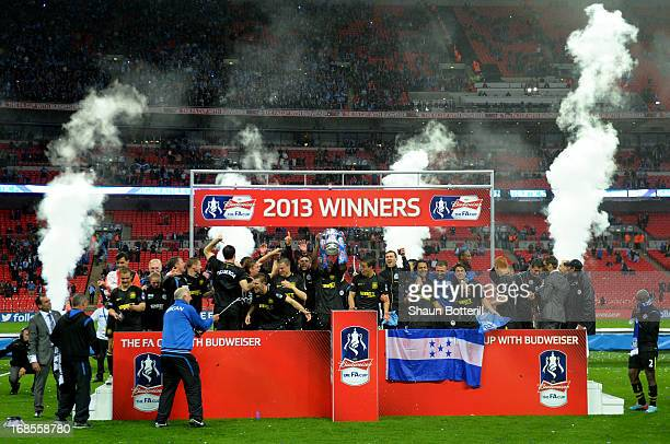 Wigan Athletic players celebrate victory after the FA Cup with Budweiser Final between Manchester City and Wigan Athletic at Wembley Stadium on May...