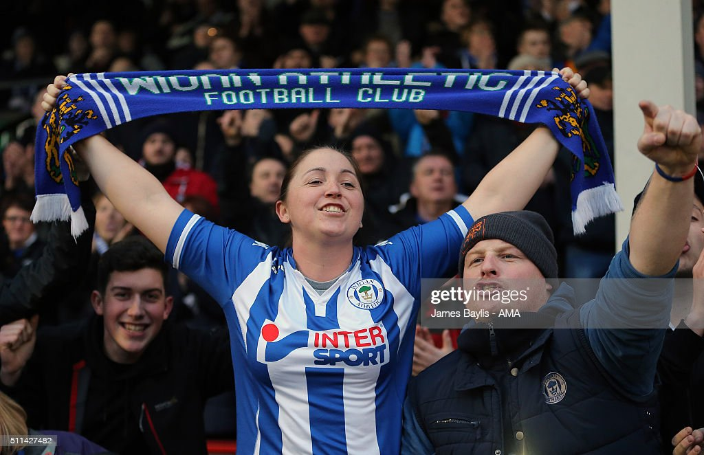 Wigan Athletic supporters celebrate victory at the end of the Sky Bet League One match between Walsall and Wigan Athletic at Bescot Stadium on February 20, 2016 in Walsall, England.