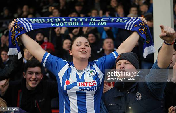 Wigan Athletic supporters celebrate victory at the end of the Sky Bet League One match between Walsall and Wigan Athletic at Bescot Stadium on...