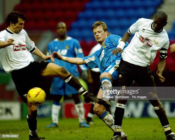 Wigan Athletic's Alan Mahon attempts to break through the Derby County defence during the Nationwide Division One match at the JJB Stadium Wigan...